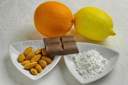 Чтобы приготовить конфеты, нужно взять миндаль, сахарную пудру, апельсиновый сок, цедру с лимона и апельсина,  шафран, шоколад.