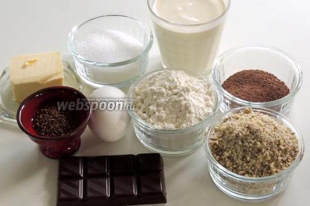 Подготовим ингредиенты: шоколад, миндаль в крошке, яйца, масло комнатной температуры, муку с разрыхлителем, какао-порошок и растворимый кофе в порошке, сахар, сливки жирностью не менее 35%.