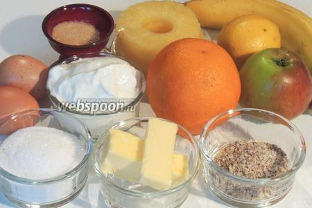 Подготовим ингредиенты: яйца, творог 0% жирности, масло, фундук в крошке, сахар, коричневый и ванильный сахар, бананы, яблоки с кислинкой, апельсин и 0,5 банки консервированного ананаса, крахмал, лимон для цедры.
