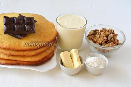 Для приготовления торта «Молочная девочка» нам понадобятся  молочные коржи , приготовленные на основе сгущённого молока, сливки жирные, сахарная пудра, шоколад чёрный, сливочное масло, орехи грецкие.