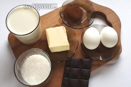 Для приготовления пудинга понадобятся молоко, сахар, кофе растворимый, крахмал, яйца, сливочное масло, какао, темный шоколад.