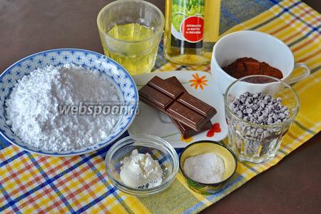 Для приготовления этого шоколадного печенья (без муки) возьмём горький шоколад, сахарную пудру, яичные белки (комнатной температуры!), какао-порошок, немного белого винного уксуса, щепотку соли и 80 г шоколадных капель (или поломанного на кусочки шоколада).