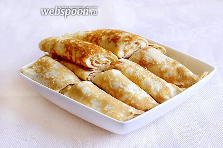 Накрыть блинчики и хранить в холодильнике. По надобности разогревать в сковороде на сливочном масле, на самом малом огне и под закрытой крышкой. Масла не жалеть, чтобы блинчики не жарились, а томились. Это необходимо и, к тому же, вкусно, так как у нас в начинке есть сырое яйцо. Приятного аппетита!