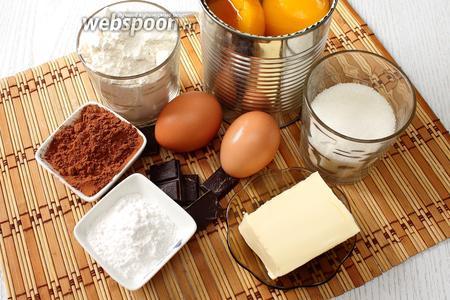 Для приготовления нам понадобятся яйца куриные, сахар, какао порошок, мука пшеничная, крахмал, молоко, разрыхлитель, консервированные персики, масло сливочное, кофе растворимый и шоколад.
