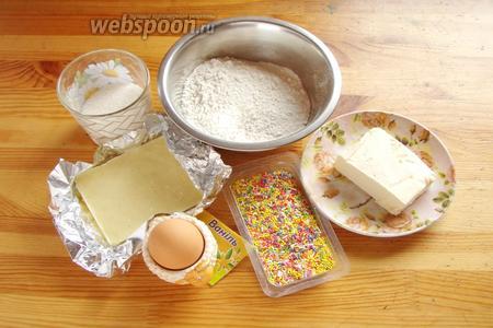Для приготовления печенья нам понадобится мука, сахар, ванилин, яйцо, сливочное масло, шоколад и кондитерская посыпка.