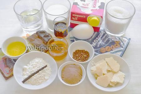 Это то, что нам нужно: мука, яйцо, растопленное сливочное масло, сахар, сливки 33%, молоко, кофе растворимый, пралине, вафельная крошка, молочный шоколад, горький шоколад, белый шоколад, стручок ванили, желатин листовой, сгущённое молоко, ликёр Амаретто, силиконовая форма диаметром 200 мм.