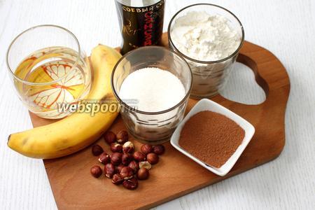 Для приготовления нам понадобятся бананы, мука пшеничная, разрыхлитель, какао порошок, сахар, сахарная пудра, масло растительное, фундук, кипяток и соевый соус.
