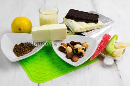 Чтобы приготовить конфеты, нужно взять шоколад чёрный и белый, сгущённое молоко, кофе, кипяток, масло сливочное, орехи, цукаты, лимонная цедра, соль.