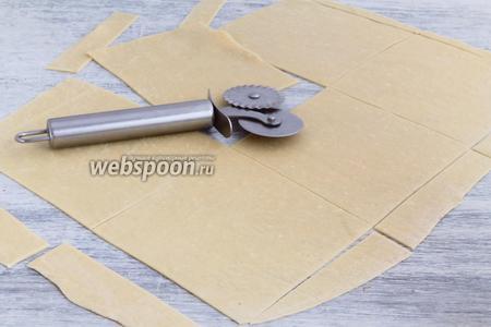 Разрезать прямоугольниками 12 на 14 см.