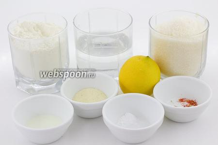 Возьмите такие продукты: муку пшеничную, соду, кефир, манную крупу, воду, сахар, лимонный сок, шафран, масло подсолнечное.