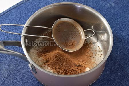 Соединить сахар (3 ст.л.) и просеянное какао (3 ст.л.). Хорошо растереть ложкой.