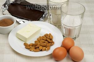Продукты, необходимые для пирога Зебра: яйца, сахарная пудра, мука, сливочное масло, какао, миндаль и чёрный шоколад.