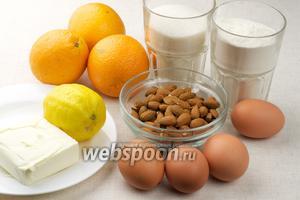 Для цитрусового кекса нужны мука, яйца, сливочное масло, сахар, апельсины и миндаль.