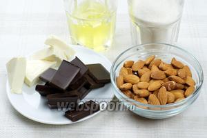 Для приготовления печенья необходимо взять 3 белка, миндаль, сахар, чёрный шоколад и мягкий сыр сливочного вкуса.
