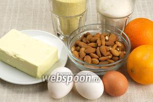 Для приготовления кекса возьмём кукурузную муку, яйца, сахар, миндаль, размягчённое сливочное масло, крупный апельсин и щепотку соли.