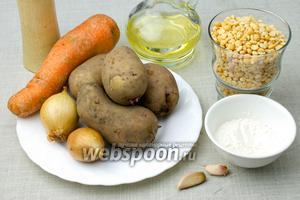 Для этого супа возьмите: 1 крупную морковь, 2 луковицы, 4 средних картофелины, стакан сухого гороха, 2 столовые ложки муки, 2 зубчика чеснока, растительное масло, лавровый лист, перец душистый.