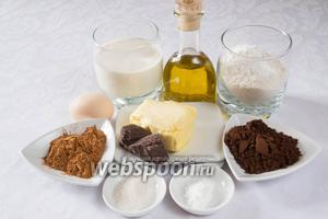Чтобы испечь шоколадный кекс, необходимо взять: сливочное масло, воду, подсолнечное масло, порошок какао, муку, сахар, соль, сливки, разрыхлитель, яйца, корицу, ванилин.