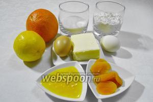 Чтобы приготовить медовый кекс, нужно взять курагу, апельсиновый (любой) ликёр, цедру одного апельсина, яйца, сахар, мёд, муку, масло, лимонный сок, тимьян, разрыхлитель.
