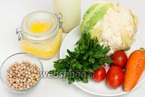 Для приготовления супа понадобится сыворотка, нут (замоченный на ночь), морковь, помидоры, капуста цветная, масло топлёное, сливки, соль, сахар, зелень и специи.