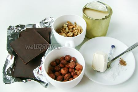 Для приготовления десерта нам понадобится чёрный шоколад и сгущённое молоко, грецкие орехи, фундук, сливочное масло, мускатный орех молотый, ароматизатор «ром» (можно обойтись без него или заменить на 0.5 ст. л. коньяка), морская соль крупного помола.