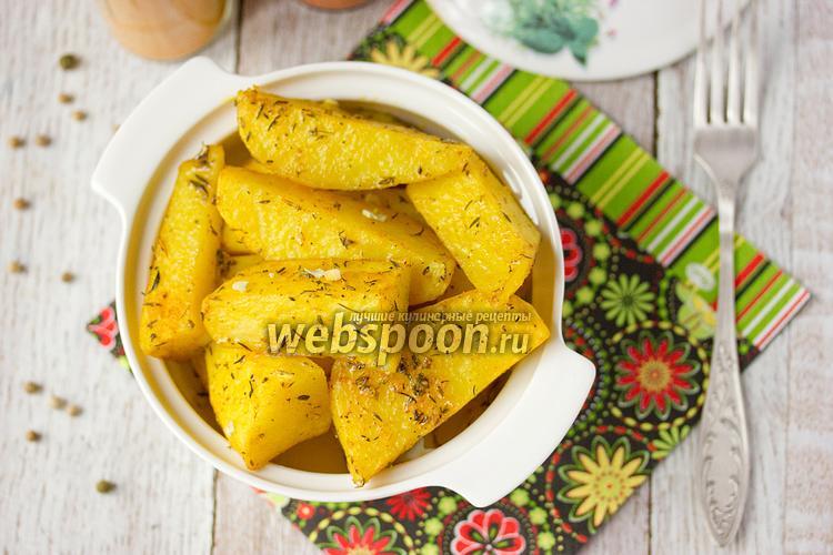 Фото Пряный золотистый картофель в микроволновке