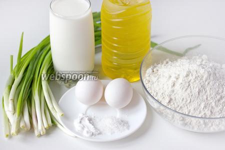 Для приготовления оладий с зелёным луком нам понадобится кефир, куриные яйца, зелёный лук, сода, соль, пшеничная мука, масло подсолнечное рафинированное.