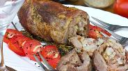 Фото рецепта Мясной рулет с салом, запечённый на веточках розмарина