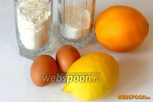 Для приготовления печенья понадобятся мука, сахарная пудра, яйца, сливочное масло, корица, апельсин (цедра), лимон (сок), разрыхлитель и водка (или коньяк).