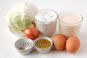 Для приготовления ленивой капустной кулебяки нам понадобится капуста, мука, ряженка, лук, соль, оливковое и подсолнечное масло, яйца, перец, сахар, сода.