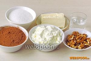 Для приготовления трюфелей нужно взять сухое молоко, сахар, какао-порошок, сливочное масло и воду.