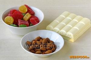 Для приготовления конфет нужно взять плитку (100 г) белого пористого шоколада, разноцветные цукаты из ананаса или других фруктов и миндаль.