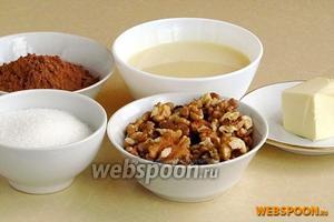 Для приготовления тянучек нужно взять сгущённое молоко, ядра грецких орехов, какао-порошок, сливочное масло и сахар.