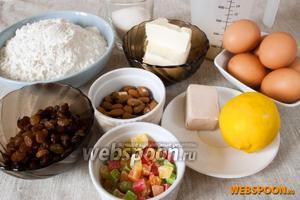 Подготовить муку, дрожжи, масло, молоко, сахар, яйца, изюм, миндаль, цукаты, лимон.