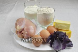 Чтобы приготовить сырный пирог, нужно взять: куриное филе, сливочное масло, яйца, сметану, твёрдый сыр, базилик, соль, орегано, паприку, разрыхлитель, муку.