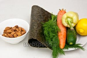 Для приготовления роллов понадобится миндаль, листья нори, укроп, лимонный сок, соль, морковь, перец и огурец.