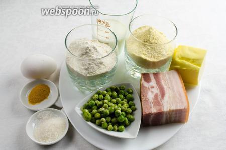 Чтобы приготовить кекс, нужно взять яйца куриные, соль, сахар, масло, молоко, муку пшеничную и кукурузную, куркуму, разрыхлитель, зелёный горошек и ветчину.