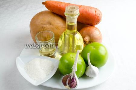 Чтобы приготовить овощную икру, необходимо взять зелёные помидоры, тыкву, морковь, лук, чеснок, подсолнечное масло, яблочный уксус, сахар, соль, чёрный молотый перец.