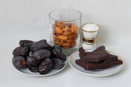 Для приготовления конфет из фиников возьмём миндаль, шоколад, финики, кокосовую стружку.