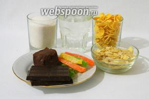 Для приготовления шоколадной ёлки возьмём шоколад, сахар, воду, шоколадное масло, миндальные лепестки, кукурузные хлопья, цукаты.
