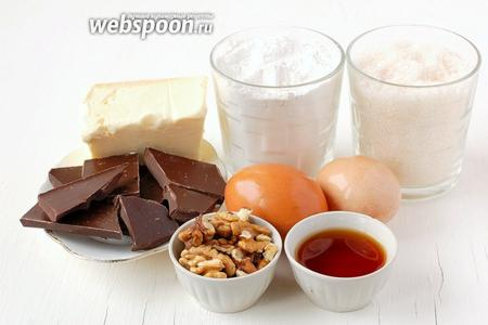 Для приготовления шоколадно-ореховых кексов нам понадобится шоколад, яйца, мука, сахар, масло сливочное, орехи, соль, разрыхлитель, коньяк.