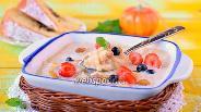 Фото рецепта Молочная рисовая каша с тыквой и орехами в мультиварке