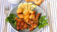 Фото рецепта Курица с картофелем, лимоном и чесноком
