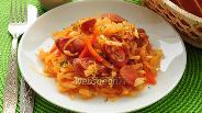 Фото рецепта Капуста тушёная с сосисками в мультиварке