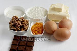 Для приготовления кекса возьмём  муку, яйца, масло, сахар, цедру апельсина, орехи, шоколад.