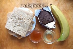 Подготовьте необходимые ингредиенты: ломтики хлеба для тостов, небольшой банан, шоколадное масло, яблочный джем и немного лимонного сока, чтобы предотвратить потемнение нарезанных бананов.