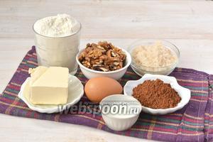 Для приготовления пирога нам понадобится мука, орехи, сахар, яйца, масло, разрыхлитель, какао.