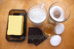 Подготовьте необходимые ингредиенты : шоколад 70%, сливочное масло комнатной температуры, сахар, ванильный сахар, муку, яйца, соль, ром (можно заменить коньяком или виски). Разогрейте духовку.