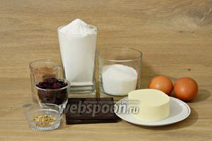 Для приготовления брауни с вишней нам понадобятся мука, разрыхлитель, сахар, какао порошок, яйца, масло сливочное, шоколад, вишня вяленая, цедра апельсина.