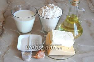 Чтобы приготовить обезьяний хлеб с сыром и чесноком, нам потребуются: мука пшеничная, молоко, масло подсолнечное и сливочное, сыр твёрдый, соль, сахар, дрожжи сухие, чеснок.