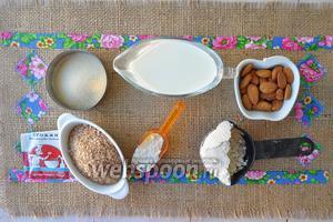 Мера стакан — 240 мл. Приготовим продукты: молоко, 2 вида муки, отруби овсяные, соль, сахар коричневый, масло сливочное, дрожжи сухие,  жаренный миндаль, вода для заваривания овсяной муки.